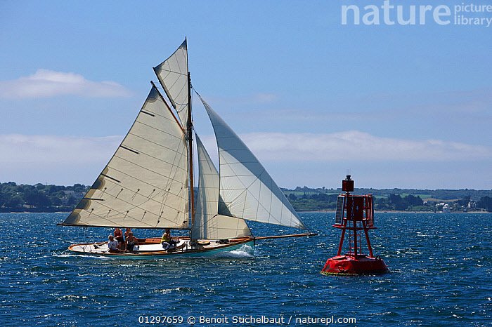 """""""Seagull"""" rounding the cardinal mark at Brest Classic Week, Brittany, France, July 2010.  ,  BOATS,BUOYS,CARDINAL MARKS,CLASSICS,COASTS,EUROPE,EVENTS,FORESAILS,FRANCE,MAINSAILS,MANOEUVRES,PROFILE,ROUNDING,SAILING BOATS,WOODEN,YACHTS  ,  Benoit Stichelbaut"""