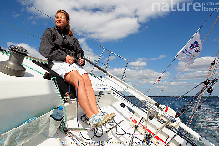 """Skipper Jeanne Gregoire trimming on board """"Banque Populaire"""" during La Solitaire du Figaro, Port la Foret Le, Brittany, France, 2010. All non-editorial uses must be cleared individually.  ,  ABOARD,BOATS,COCKPITS,EUROPE,FRANCE,HEELING,PROCEDURES,RACES,ROPES,SAILING BOATS,SHEETS,SKIPPER,TRIMMING,WINCHES,WOMAN,YACHTS,BOAT-PARTS,CREWS ,PEOPLE ,core collection xtwox  ,  Benoit Stichelbaut"""