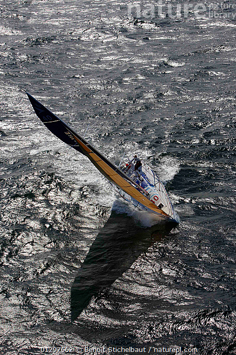 """""""Banque Populaire"""" during La Solitaire du Figaro, Port la Foret Le, Brittany, France, 2010.  ,  AERIALS,BOATS,EUROPE,FRANCE,FRONT VIEWS,HEELING,RACES,SAILING BOATS,SHADOW,SHADOWS,SILVERY,VERTICAL,YACHTS,core collection xtwox  ,  Benoit Stichelbaut"""