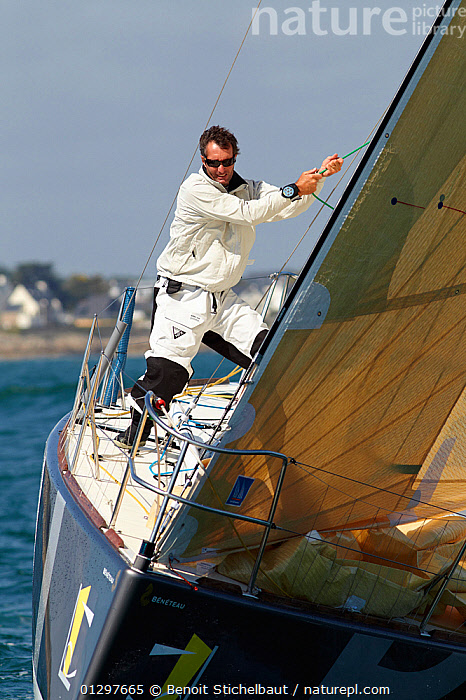 """Skipper Jeremie Beyou hoisting spinnaker on board """"BPI"""" during La Solitaire du Figaro, Port la Foret Le, Brittany, France, 2010. All non-editorial uses must be cleared individually.  ,  BOATS,COASTS,EUROPE,FRANCE,FRONT VIEWS,HOISTING,MAN,MS,PROCEDURES,RACES,SAILING BOATS,SKIPPER,SPINNAKERS,VERTICAL,YACHTS,PEOPLE ,CREWS ,SAILS ,core collection xtwox  ,  Benoit Stichelbaut"""