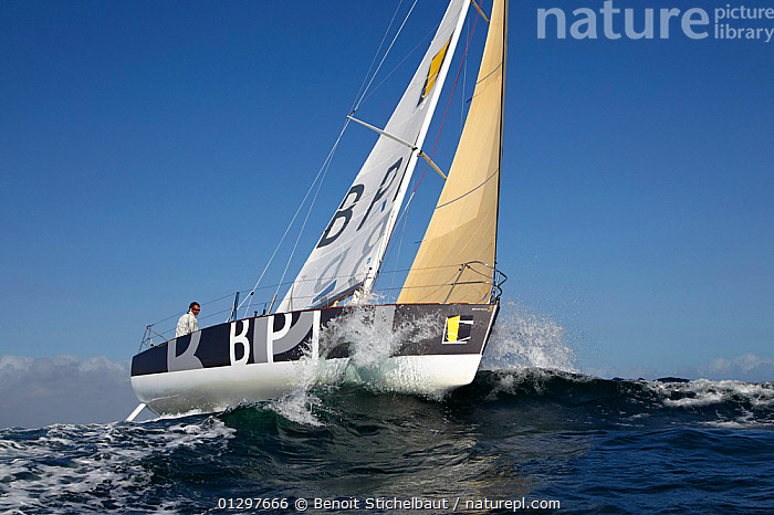 """Skipper Jeremie Beyou on board """"BPI"""" during La Solitaire du Figaro, Port la Foret Le, Brittany, France, 2010.  ,  BOATS,EUROPE,FRANCE,LOW ANGLE SHOT,RACES,SAILING BOATS,SPRAY,YACHTS,core collection xtwox  ,  Benoit Stichelbaut"""