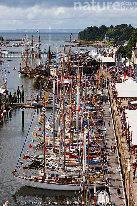 Boat festival at Port Rhu, Douarnenez, Brittany, France, July 2010.  ,  BOATS,COASTS,EUROPE,FESTIVALS,FLAGS,FRANCE,HARBOURS,MOORED,SAILING BOATS,TOWNS,VERTICAL,YACHTS  ,  Benoit Stichelbaut