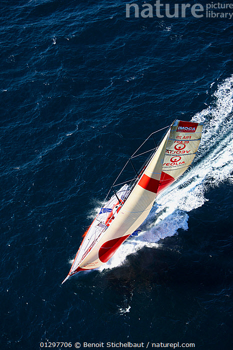 """Aerial view of """"Veolia Environment 2"""", skippered by Roland Jourdain, during qualification for 2010 Route du Rhum, France, 2010.  ,  AERIALS,BOATS,EUROPE,FRANCE,MAINSAILS,SAILING BOATS,SPEED,SPINNAKERS,VERTICAL,WAKE,YACHTS,SAILS  ,  Benoit Stichelbaut"""