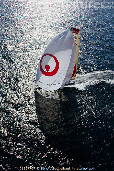 "Aerial view of ""Veolia Environment 2"", skippered by Roland Jourdain, during qualification for 2010 Route du Rhum, France, 2010.  ,  AERIALS,BOATS,EUROPE,FRANCE,FREEDOM,MAINSAILS,PROFILE,SAILING BOATS,SHADOW,SHADOWS,SPINNAKERS,SUNNY,VERTICAL,YACHTS,CONCEPTS,SAILS ,core collection xtwox  ,  Benoit Stichelbaut"