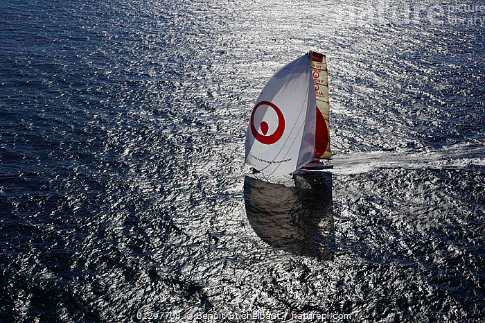"""Aerial view of """"Veolia Environment 2"""", skippered by Roland Jourdain, during qualification for 2010 Route du Rhum, France, 2010.  ,  AERIALS,BOATS,EUROPE,FRANCE,MAINSAILS,PROFILE,SAILING BOATS,SHADOW,SHADOWS,SILVERY,SPINNAKERS,SUNNY,YACHTS,SAILS ,core collection xtwox  ,  Benoit Stichelbaut"""
