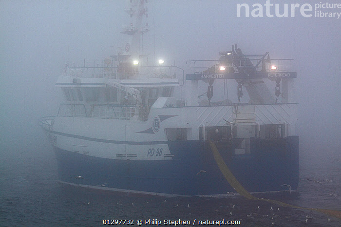 """Trawler """"Harvester"""" shrouded in mist on the North Sea, July 2010. Property released.  ,  BOATS,EUROPE,FISHERIES,FISHING BOATS,LIGHTS,MIST,NORTH SEA,OBSCURED,TRAWLERS,WEATHER,WORKING BOATS,WORKING-BOATS  ,  Philip Stephen"""