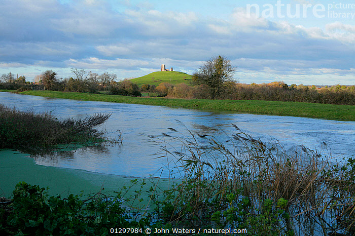 The River Parrett in the foreground flows past Burrow Mump and its ruined church in the background  Near Othery, Somerset, England, UK, November 2009  ,  BUILDINGS,CHURCHES,COUNTRYSIDE,ENGLAND,EUROPE,LANDSCAPES,RIVERS,RUINS,UK,WATER,WINTER,United Kingdom  ,  John Waters
