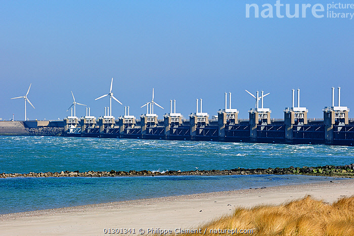 Oosterscheldekering / Eastern Scheldt storm surge barrier, the largest of 13 dams designed to protect the Netherlands from flooding. Neeltje Jans, Netherlands, March 2010  ,  alternative energy,BEACHES,blue sky,CATALOGUE2,COASTS,Dam,dams,DEFENSES,Eastern Scheldt ,engineering,ENVIRONMENTAL,EUROPE,floods,group of objects,HOLLAND,in a row,Infrastructure,LANDSCAPES,large group of objects,man made structure,Neeltje Jans,netherlands,Nobody,Oosterscheldekering,outdoors,perspective,precaution,proctection,protection,sea,sea defense,seas,storm surge barrier,WATER,wind turbine,wind turbines,core collection xtwox  ,  Philippe Clement