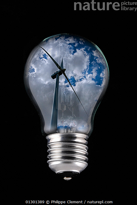 Wind farm turbine against cloudy sky seen inside incandescent lamp / bulb against black background Digital composite, alternative energy,black background,CATALOGUE2,close up,CLOSE UPS,cloudy,concepts,digital composite,electricity,ENERGY,ENVIRONMENTAL,environmental concern,green issues,ideas,lightbulb,Nobody,one object,power,SKY,studio shot,sustainability,thoughts,wid power,WIND,wind farm,wind turbine,Weather, Philippe Clement