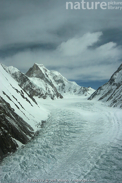 Aerial view of K2 and glaciated valley of Concordia, Karakoram Mountains, Himalayas, Pakistan. From Pakistani military helicopter for BBC series Planet Earth April 2005, access,aerial view,AERIALS,ASIA,BBC,CATALOGUE2,cloudy,concordia,DRAMATIC,elevated view,FILMING,GLACIERS,high altitude,himalayas,K2,Karakoram Mountains,LANDSCAPES,mountain peak,MOUNTAINS,mountaintop,nature,NHU,Nobody,Ominous,outdoors,pakistan,Physical Geography,ridge,Savage Mountain,SKY,SNOW,snow capped,storm cloud,valley,VERTICAL,CONCEPTS,Geology,INDIAN-SUBCONTINENT, Jeff Wilson