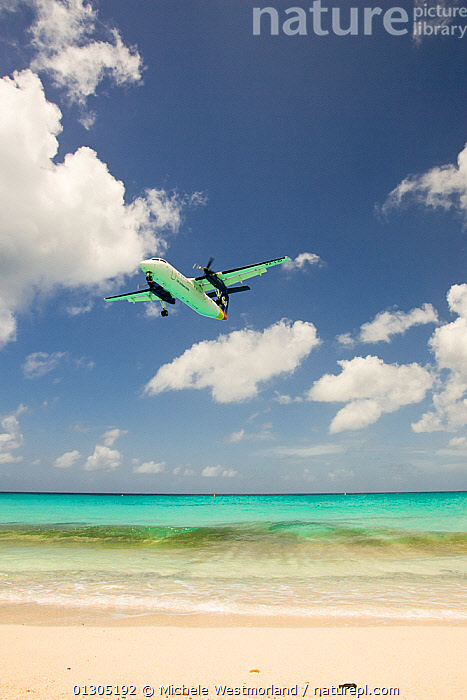Aeroplane landing at Juliana Airport, Maho Bay, near Philipburg, St. Maarten (Dutch side of island) Caribbean. August 2006.  ,  aeroplane,air pollution,AIRCRAFT,arrival,BEACHES,CARIBBEAN,CATALOGUE2,CLOUDS,cloudy,environmental concern,HOLIDAYS,horizon,horizon over water,Juliana Airport,LANDING,LANDSCAPES,Maho Bay,Nobody,OCEAN,one object,outdoors,paradise,Philipburg,sand,seas,SKY,st maarten ,TOURISM,Transport,transportation,Travel,vacations,VERTICAL,view to sea,West Indies,Weather,Concepts,core collection xtwox  ,  Michele Westmorland