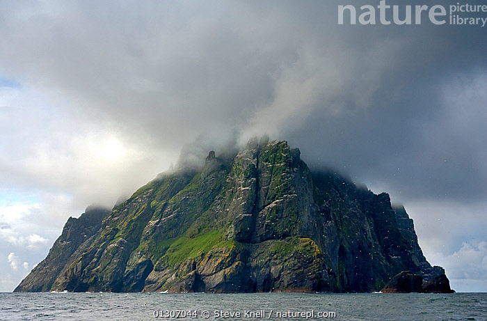Boreray, under low cloud cover. This holds the largest gannetry in UK (60,000 pairs) St. Kilda, Scotland, July 2009, ATMOSPHERIC,bad weather,Boreray,catalogue3,CLIFFS,cloud cover,CLOUDS,COASTS,DRAMATIC,EUROPE,gannetry,GEOLOGY,Island,ISLANDS,July,LANDSCAPES,low cloud ,meteorology,nature,Nobody,Ominous,outdoors,Physical Geography,remote,rock face,Scenics,sea,SKY,St Kilda,storm cloud,Travel,UK,view to land,WEATHER,CONCEPTS,United Kingdom,core collection xtwox,Wonder,Spectacular,, STEVE KNELL