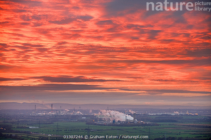 Shell, Stanlow Oil Refinery at sunset, Ellesmere Port, Cheshire, England, December 2009.  ,  ATMOSPHERIC,BUILDINGS,EUROPE,INDUSTRY,LANDSCAPES,OIL,PETROLEUM,POLLUTION,RED,SKY,SMOKE,SUNSET,UK,URBAN,ENGLAND,United Kingdom  ,  Graham Eaton