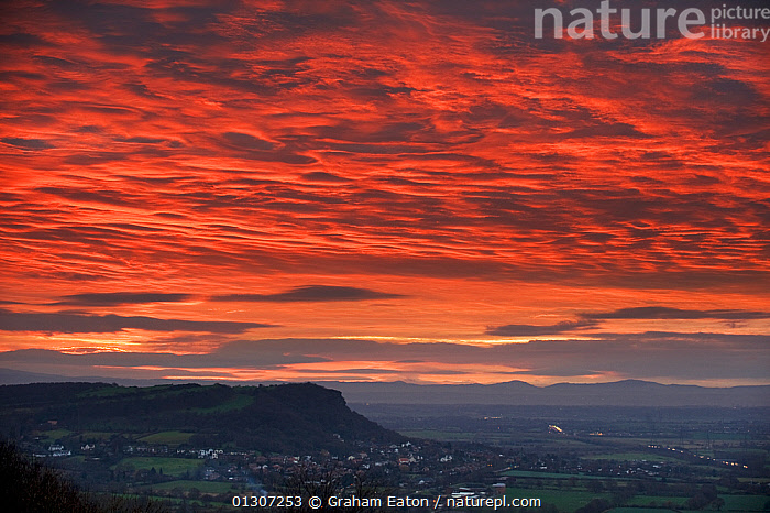 Dramatic sunset at Helsby Hill, Cheshire, December 2009  ,  ATMOSPHERIC,BUILDINGS,CLOUDS,COUNTRYSIDE,DRAMATIC,EUROPE,LANDSCAPES,NIGHT,RED,SKY,SUNSET,TOWNS,UK,WINTER,Weather,United Kingdom  ,  Graham Eaton