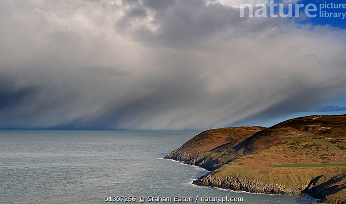 Snow-bearing clouds approaching the coast, viewed from the old coastguard station, Aberdaron, Gwynedd, Wales, January 2010  ,  CLOUDS,COASTS,DRAMATIC,EUROPE,LANDSCAPES,SEA,SKY,SNOW,SNOWSTORM,UK,WALES,WINTER,Weather,CONCEPTS,United Kingdom  ,  Graham Eaton