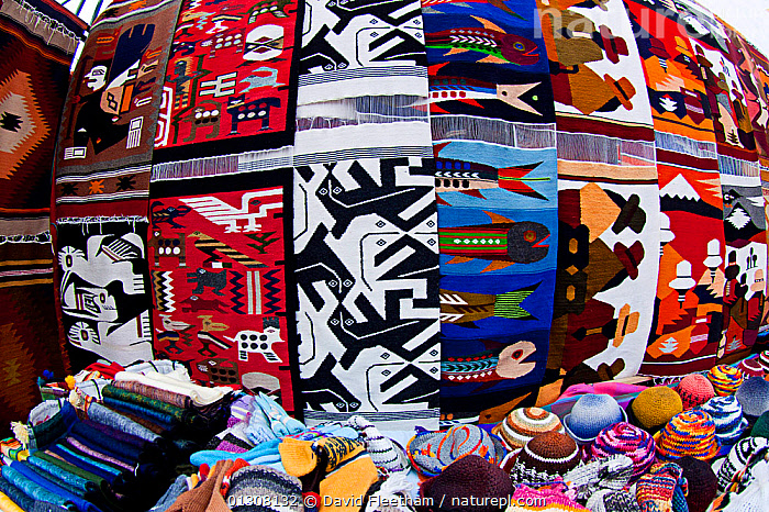 Handmade weavings for sale in a large Indian market in the town of Otavalo, Ecuador., CLOTHING,COLOURFUL,craft,crafts,Ecuador,markets,rugs,SOUTH AMERICA,TRADE,TRADITIONAL,woven,SOUTH-AMERICA, David Fleetham