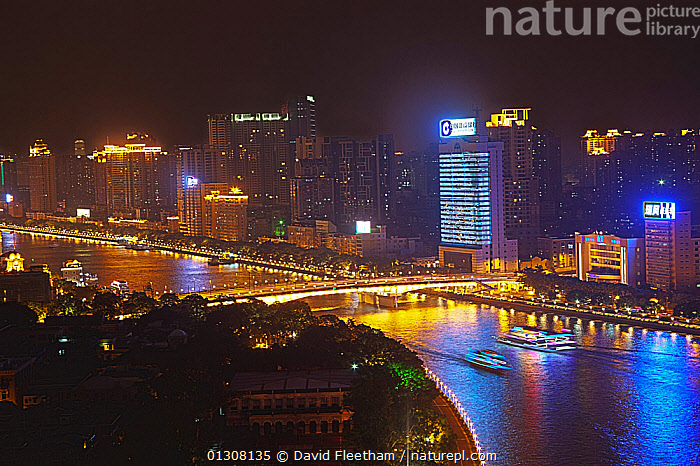 Dinner cruise vessels on Zhujiang River at night. Guangzhou, Guangdong, China. Digitally composed., ASIA,BOATS,BUILDINGS,CHINA,CITIES,HIGH RISE,LANDSCAPES,LIGHTS,NIGHT,RIVERS,URBAN, David Fleetham