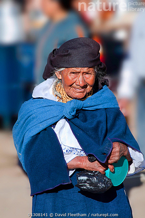 Elderly woman in Indian market in the town of Otavalo, Ecuador. Editorial use only., CLOTHING,ELDERLY,HISPANIC,PEOPLE,PORTRAITS,SOUTH AMERICA,TRADITIONAL,VERTICAL,WOMAN,SOUTH-AMERICA, David Fleetham