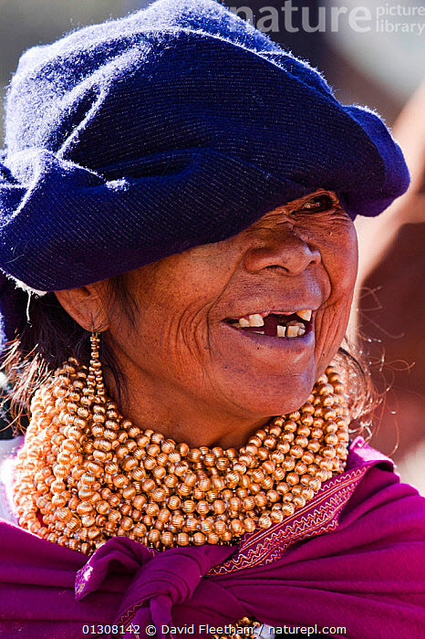 Elderly woman in Indian market in the town of Otavalo, Ecuador. Editorial use only., CLOTHING,ELDERLY,HAT,HATS,HISPANIC,PEOPLE,PORTRAITS,SMILING,SOUTH AMERICA,TEETH,TRADITIONAL,VERTICAL,WOMAN,SOUTH-AMERICA, David Fleetham