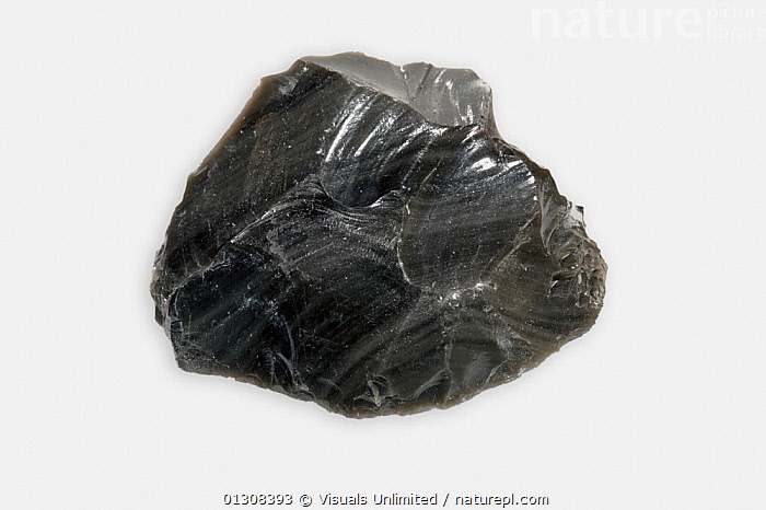 Obsidian, a glassy extrusive volcanic or igneous rock., CLOSE UP,COLOR,EARTH,GEOLOGY,GLASS,IGNEOUS,IMAGE,INDOORS,LIFE,MINERAL,MINERALS,NATURAL,OBJECT,OBSIDIAN,ROCKS,ROUGH,SCIENTIFICA,SHOT,SINGLE,SPECIMEN,STILL,STUDIO,VOLCANIC,WHITE, Visuals Unlimited