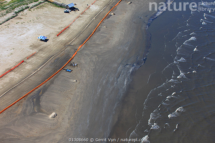 Aerial view of Slickbar oil booms on the beach at Grand Isle, used in the clean up and containment of hazardous oil, from the BP Deepwater Horizon spill in the Gulf of Mexico. Jefferson Parish, Louisiana. USA, July 2010., AERIALS,BEACHES,British Petroleum,COASTS,contaminated,CRUDE OIL,DEEPWATER HORIZON,disaster,ENVIRONMENTAL,LANDSCAPES,NORTH AMERICA,OIL,POLLUTION,response,RIVERS,sand,spill,USA,WAVES, Gerrit Vyn