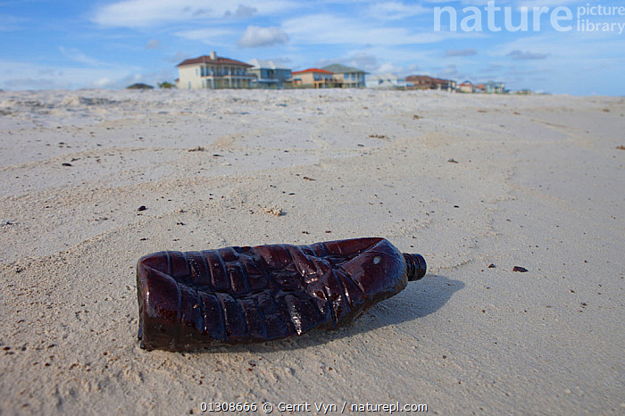 A plastic bottle covered in oil on a beach. This beach was repeatedly contaminated with oil by the BP Deepwater Horizon spill. Baldwin County, Alabama, USA June 2010., BEACHES,British Petroleum,BUILDINGS,contaminated,CRUDE OIL,DEEPWATER HORIZON,disaster,ENVIRONMENTAL,LANDSCAPES,litter,MEXICO,NORTH AMERICA,OIL,plastic,POLLUTION,REFUSE,rubbish,sand,shores,slick,spill,USA,CENTRAL-AMERICA, Gerrit Vyn