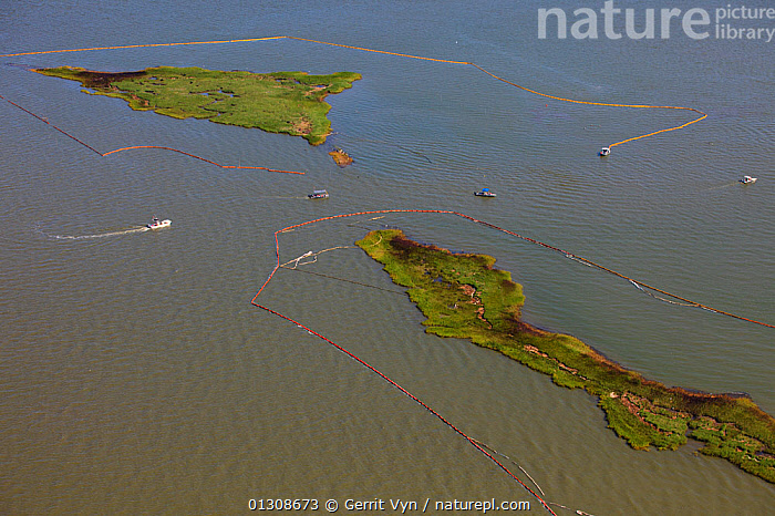 Aerial view of oiled bird nesting colonies in Barataria Bay area of the Mississippi River delta, with oil spill containment booms attempting to prevent more oil coming ashore. These waters are contaminated as a result of the BP Deepwater Horizon leak in the Gulf of Mexico. Plaquemines Parish, Louisiana, USA, July 2010.  ,  AERIALS,BEACHES,BIRDS,breeding colonies,British Petroleum,COASTS,contamination,CRUDE OIL,DEEPWATER HORIZON,ENVIRONMENTAL,LANDSCAPES,OIL,POLLUTION,response,RIVERS,slick,spill,USA,WETLANDS,North America  ,  Gerrit Vyn