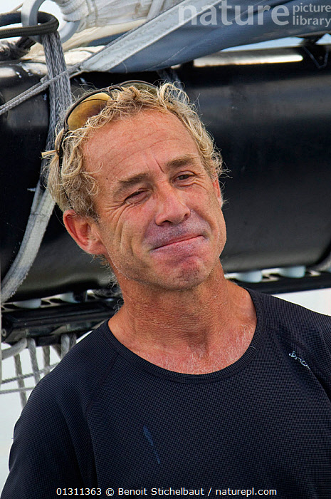 """Monocoque 60 """"Veolia Environment"""" skipper Roland Jourdain arriving in Guadeloupe as winner of Route du Rhum IMOCA Class. November 2010. Editorial use only., BOATS,CARIBBEAN,CENTRAL AMERICA,CREWS,GUADELOUPE,MAN,PEOPLE,PORTRAITS,RACES,RUM RACE,SAILING BOATS,SKIPPER,SMILING,VERTICAL,WEST INDIES,WINNER,WINNERS,YACHTS,core collection xtwox, Benoit Stichelbaut"""