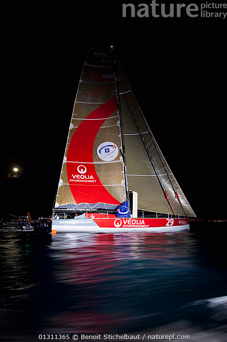 """Monocoque 60 """"Veolia Environment"""" skippered by Roland Jourdain arriving in Guadeloupe as winner of Route du Rhum IMOCA Class. November 2010. Editorial use only., BOATS,CARIBBEAN,CENTRAL AMERICA,COASTS,FORESAILS,GUADELOUPE,MAINSAILS,NIGHT,PROFILE,RACES,RUM RACE,SAILING BOATS,VERTICAL,WEST INDIES,WINNER,WINNERS,YACHTS,core collection xtwox, Benoit Stichelbaut"""