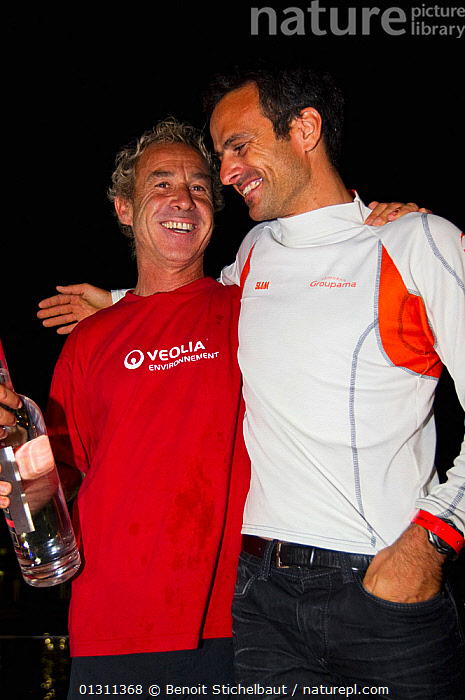 """Monocoque 60 """"Veolia Environment"""" skipper Roland Jourdain with Franck Cammas after Jourdain wins Route du Rhum IMOCA Class. November 2010. Editorial use only., CARIBBEAN,CELEBRATIONS,CENTRAL AMERICA,CREWS,FRIENDS,GUADELOUPE,MEN,PEOPLE,RACES,RUM RACE,SMILING,SUCCESS,TWO,VERTICAL,WEST INDIES,WINNER,WINNERS,core collection xtwox, Benoit Stichelbaut"""