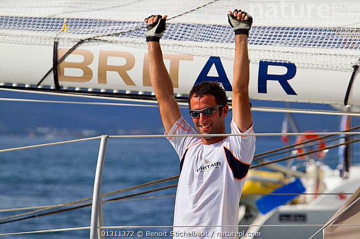 """Skipper Armel le Cleac'h celebrating on board Monocoque 60 """"Brit Air"""" finishing in second place of Route du Rhum IMOCA Class. Guadeloupe, November 2010. Editorial use only., BOATS,CARIBBEAN,CELEBRATIONS,CENTRAL AMERICA,GUADELOUPE,MAN,PEOPLE,RACES,RUM RACE,SAILING BOATS,SKIPPER,SUCCESS,WEST INDIES,YACHTS,CREWS ,core collection xtwox, Benoit Stichelbaut"""