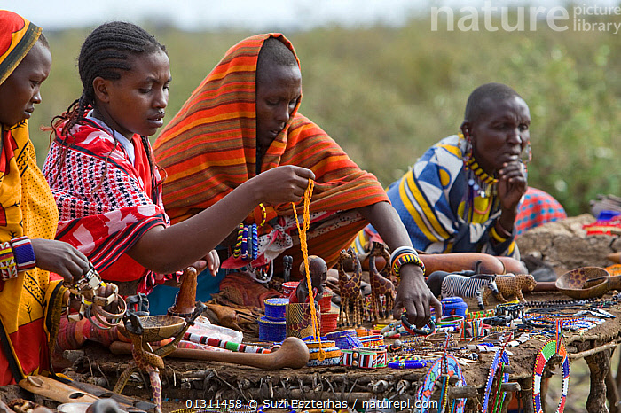 Maasai women selling beaded jewellery and crafts to tourists. Near Masai Mara Reserve, Kenya, East Africa, August 2008, AFRICA,CULTURES,EAST AFRICA,MAASAI,OUTDOORS,PEOPLE,TOURISM,TRADITIONAL,TRIBES,WOMEN, Suzi Eszterhas