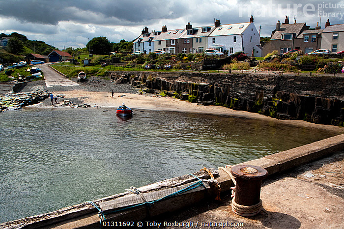 Craster Harbour, Northumberland Coast Area of Outstanding Natural Beauty (AONB), England, July 2010.  ,  BEACHES,BOATS,COASTS,ENGLAND,EUROPE,HARBOURS,HOMES,LANDSCAPES,LAUNCHING,OPEN BOATS,RESERVE,SLIPWAYS,SMALL,TOWNS,UK,SIZE ,United Kingdom  ,  Toby Roxburgh