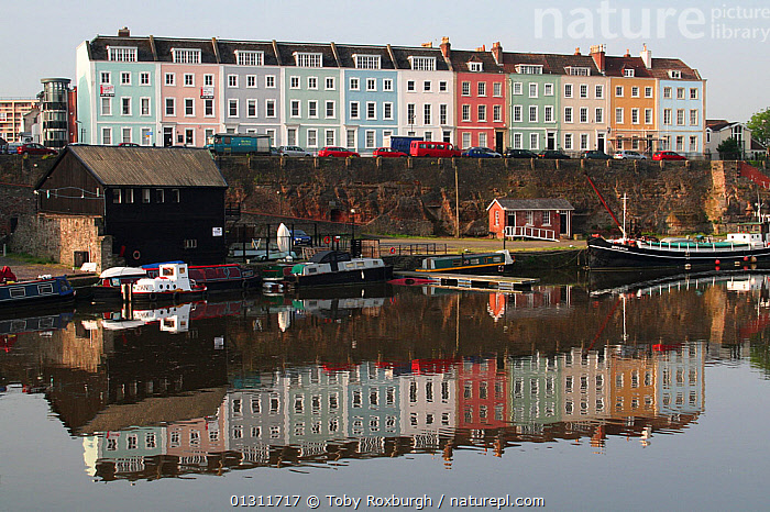 Terrace of colourful houses on Redcliffe Quay, reflected in the water of Bristol's floating Harbour in early morning, Bristol, England, May 2008., BARGES,BOATS,BUILDINGS,CALM,CITIES,COLOURFUL,ENGLAND,EUROPE,HARBOURS,MOORED,PROFILE,REFLECTIONS,RIVERS,TOWNS,UK,United Kingdom, Toby Roxburgh