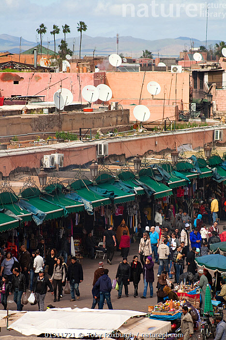 Market stalls and shops around the Djemma el Fna, Marrakech, Morocco, February 2010., AFRICA,BUILDINGS,CITIES,CROWDED,HIGH ANGLE SHOT,MARKETS,MOROCCO,NORTH AFRICA,PEOPLE,SATELLITE DISHES,SHOPPING,TOURISM,TRADE,VERTICAL,NORTH-AFRICA, Toby Roxburgh