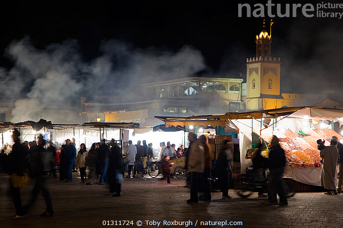 Busy market at night, Marrakech, Morocco, February 2010., AFRICA,ATMOSPHERIC,BLUR,BLURRY,BUILDINGS,CITIES,CROWDED,LIGHTS,MARKETS,MOROCCO,MOVEMENT,NIGHT,NORTH AFRICA,PEOPLE,SHOPPING,SMOKE,TIME EXPOSURE,TOURISM,TRADE,NORTH-AFRICA, Toby Roxburgh