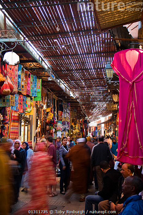 Busy market in Marrakech, Morocco, March 2010., AFRICA,BLUR,BLURRY,CITIES,CLOTHING,COLOURFUL,CROWDED,INTERIORS,MARKETS,MOVEMENT,NORTH AFRICA,PEOPLE,SHOPPING,TIME EXPOSURE,TOURISM,TRADE,VERTICAL,NORTH-AFRICA, Toby Roxburgh