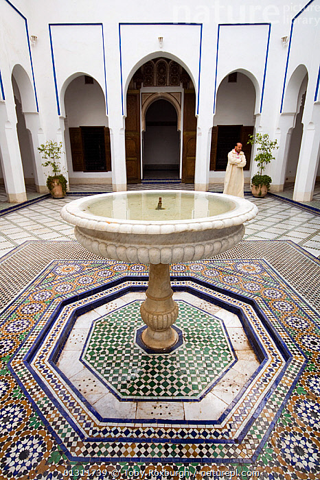 Courtyard fountain, Bahia Place, Marrakech, Morocco, March 2010., AFRICA,ARCHITECTURE,BUILDINGS,CITIES,COURTYARDS,FOUNTAINS,MOROCCO,MOSAIC,MOSAICS ,NORTH AFRICA,PALACES,PATTERNS,PEOPLE,VERTICAL,NORTH-AFRICA, Toby Roxburgh