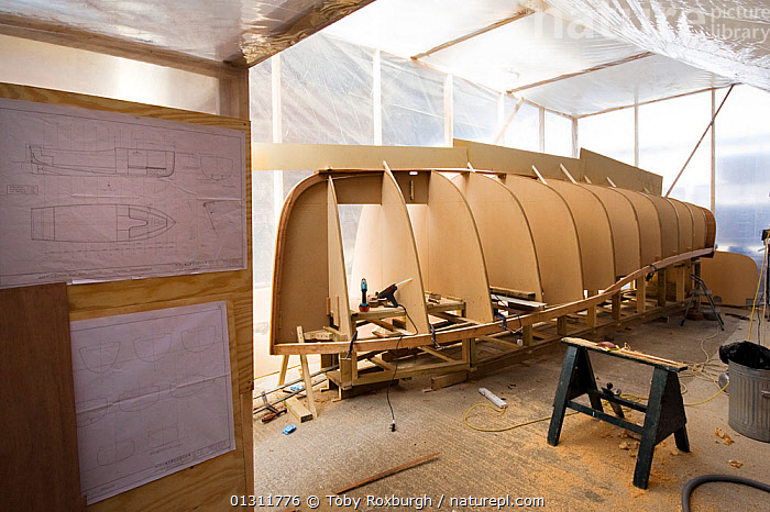 Hull of wooden cutter under construction at the Underfall Yard, Bristol, England, April 2010., BOATBUILDING,BOAT BUILDING,BOATS,BRISTOL,BUILDINGS,CONSTRUCTION,CUTTERS,DRY LAND,ENGLAND,EUROPE,HULLS,KEELS ,SAILING BOATS,UK,UPSIDE DOWN,WOODEN,SAILING-BOATS ,BOAT-PARTS,United Kingdom,core collection xtwox, Toby Roxburgh