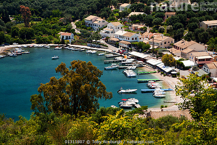 Aerial view of San Stefanos Bay, Corfu, Greece, June 2010.  ,  AERIALS,ANCHORAGES,BEACHES,BOATS,BUILDINGS,COASTS,CORFU,CRUISING,EUROPE,GREECE,HARBOURS,HIGH ANGLE SHOT,ISLANDS,LANDSCAPES,MEDITERRANEAN,MIXED BOATS,MOORED,MOTORBOATS,TOWNS,core collection xtwox  ,  Toby Roxburgh