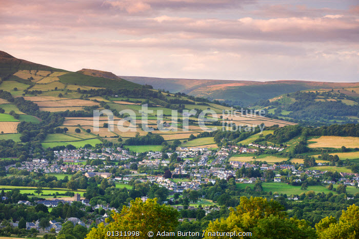 View of the towns of Crickhowell / Crug Hywel and Llangattock / Llangatwg in the Usk Valley, Brecon Beacons National Park, Powys, Wales, UK. July 2009, BRECON BEACONS,BUILDINGS,COUNTRYSIDE,EUROPE,FARMLAND,FIELDS,HILLS,HORIZON,LANDSCAPES,NP,RURAL,SUMMER,TOWNS,UK,UPLAND,VILLAGES,National Park,United Kingdom, Adam Burton