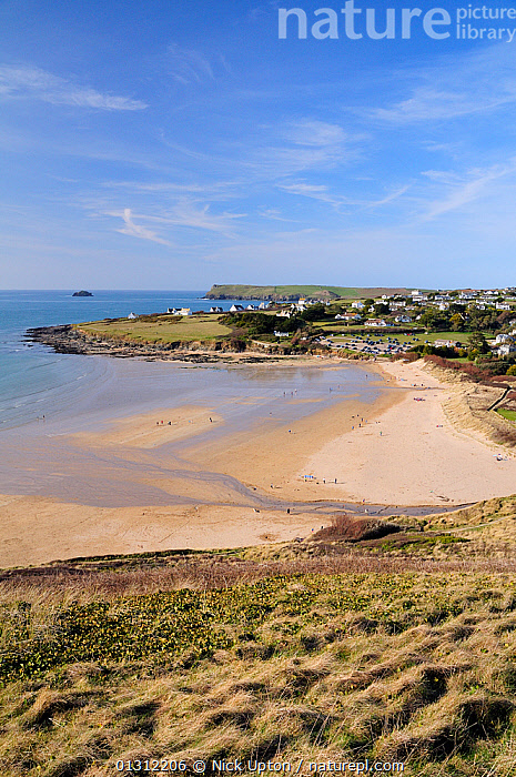 View of Daymer Bay, Trebetherick and Pentire Head from Brae Hill, north Cornwall, UK, April 2010., BEACHES,BOATS,COASTS,ENGLAND,ESTUARIES,EUROPE,HEADLANDS,LANDSCAPES,LEISURE,PEOPLE,RECREATIONAL,SAND,SEA,SPRING,SUNNY,TOURISM,UK,VERTICAL,United Kingdom, Nick Upton