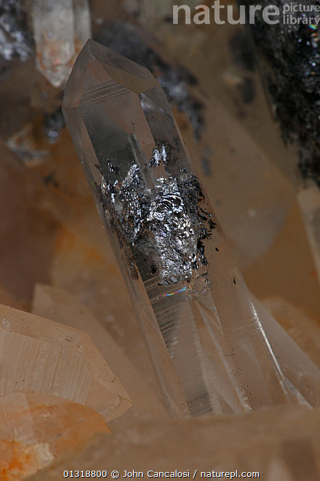 Quartz (SiO2 / silicon dioxide) The most common mineral on earth, used in making glass, galena inclusions rare  ,  CRYSTALS,GEOLOGY,MINERALS,ROCKS  ,  John Cancalosi