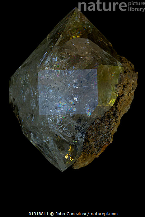 Herkimer Diamond, a double terminated quartz crystal (SiO2 / silicon dioxide) Many industrial uses including glass  ,  CRYSTALS,GEMS,GEOLOGY,MINERALS,ROCKS  ,  John Cancalosi