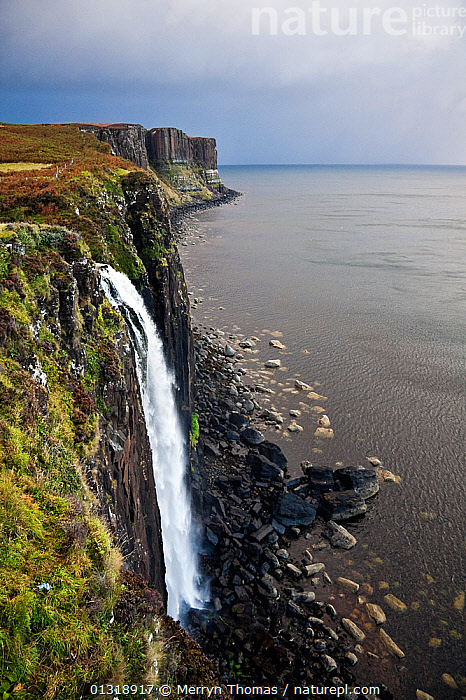 Kilt Rock and Loch Mealt waterfall under stormy skies in the morning, bassalt columns visible. Trotternish Peninsula, Isle of Skye, Scotland. September 2010.  ,  ATMOSPHERIC,bassalt ,catalogue3,CLIFFS,coastal,coastline,COASTS,column,DRAMATIC,elevated view,EUROPE,GEOLOGY,ISLANDS,isle of skye,Kilt Rock,LANDSCAPES,Loch Mealt waterfall,Morning,nature,Nobody,outdoors,perspective,ROCK FORMATIONS,ROCKS,scenery,Scenic,SCOTLAND,sea,storm cloud,STORMS,Trotternish Peninsula,UK,VERTICAL,waterfall,WATERFALLS,WEATHER,CONCEPTS,United Kingdom,core collection xtwox  ,  Merryn Thomas
