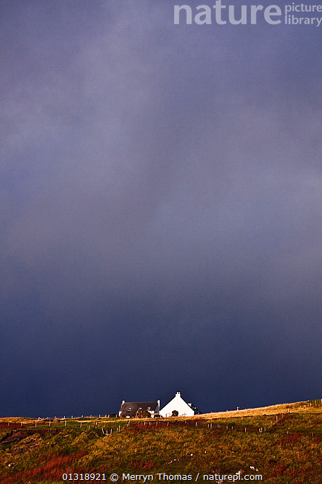Lone house beneath stormy skies. Elgol, Isle of Skye, Scotland. September 2010.  ,  ALONE,ATMOSPHERIC,BUILDINGS,COUNTRYSIDE,EUROPE,HEATHLAND,HOMES,LANDSCAPES,SKIES,STORMS,UK,VERTICAL,WEATHER,CONCEPTS,United Kingdom,core collection xtwox  ,  Merryn Thomas