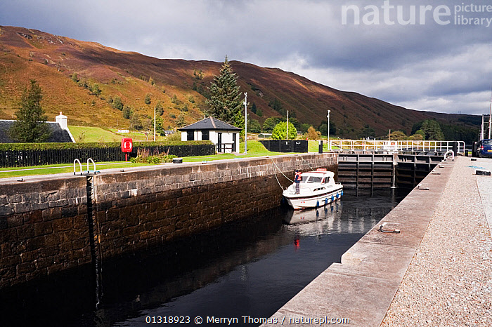Motorboat in Laggan Locks, Caledonian Canal, Great Glen, Highlands, Scotland. September 2010.  ,  BOATS,BUILDINGS,CANALS,EUROPE,FRONT VIEWS,LOCK,MOORED,MOTORBOATS,REFLECTIONS,SCOTLAND,UK,United Kingdom,core collection xtwox  ,  Merryn Thomas