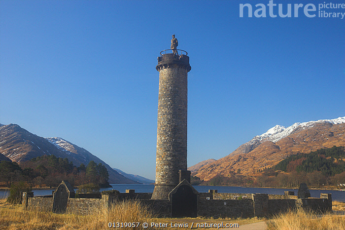 Glenfinnan and the Princes Monument to the Jacobites. Loch Shiel, Scotland, March 2010.  ,  BUILDINGS,COUNTRYSIDE,EUROPE,HIGHLANDS,LANDSCAPES,memorials,monuments,MOUNTAINS,SCOTLAND,UK,WATER,United Kingdom  ,  Peter Lewis