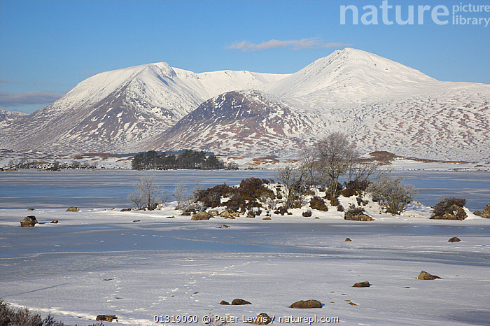 Loch na h' Achlaise frozen over with Black Mount in the distance. Rannoch Moor, Scotland, March 2010.  ,  COUNTRYSIDE,EUROPE,Frozen,HIGHLANDS,LAKES,LANDSCAPES,MOUNTAINS,Nobody,SCOTLAND,SNOW,UK,WINTER,United Kingdom  ,  Peter Lewis