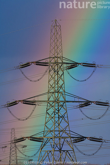 Rainbow behind electricity pylon and power lines, Ferrybridge power station. Yorkshire, England, UK, March 2008.  ,  COLOURFUL,ELECTRICITY,ENERGY,EUROPE,INDUSTRY,POWER,RAINBOWS,UK,VERTICAL,WEATHER,United Kingdom  ,  Peter Cairns